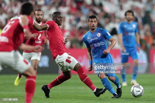 Ahly's midfielder Aliou Dieng vies for the ball against Zamalek's midfielder Tarek Hamed during the Egyptian Super Cup final football match between...