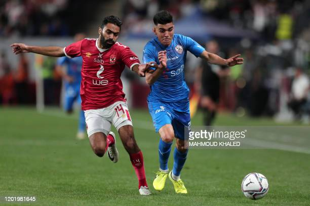 Ahly's midfielder Hussein el Shahat vies for the ball against Zamalek's forward Achraf Bencharki during the Egyptian Super Cup final football match...