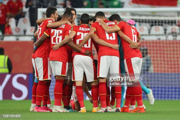 Ahly's players gather in a huddle ahead of the FIFA Club World Cup 3rd place football match between Egypt's Al-Ahly vs Brazil's Palmeiras at the...