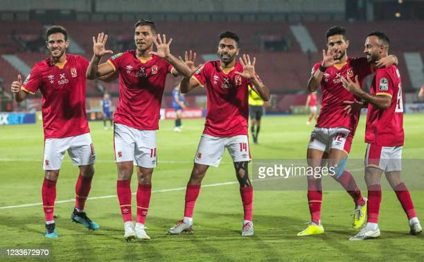 """Ahly's players show the number """"10"""" with their hands as they celebrate after winning the second leg of the CAF champions league semi-final football..."""