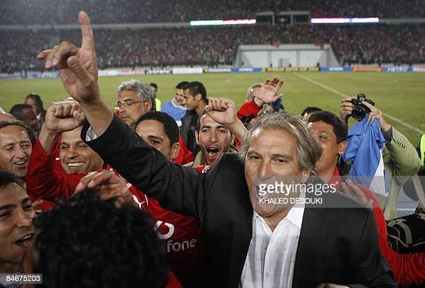 Ahly's Portuguese coach Manuel Jose dances as he celebrate with his footballers after winning against Tunis�s Sfaxien club in the final football...