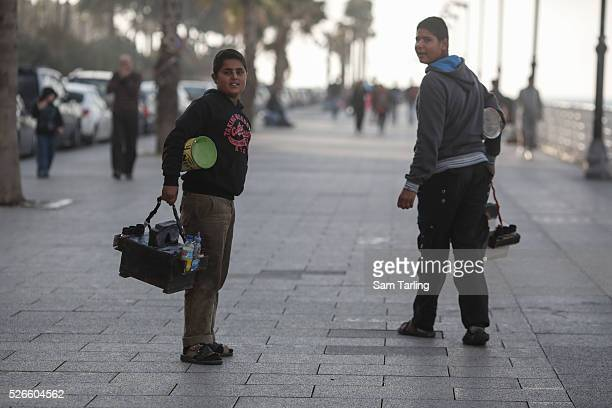 Ahmad and Mohammad both refugees from Deraa Syria look for shoeshining customers on Beirut's seafront promenade on Saturday March 1 2014 There are...