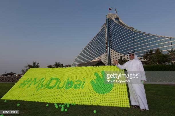 E Ahmad AbdulMalik Ahli poses with the World's largest tennis ball mosaic that is a reproduction of HH Sheikh Mohammed Bin Rashid Al Maktoum UAE Vice...