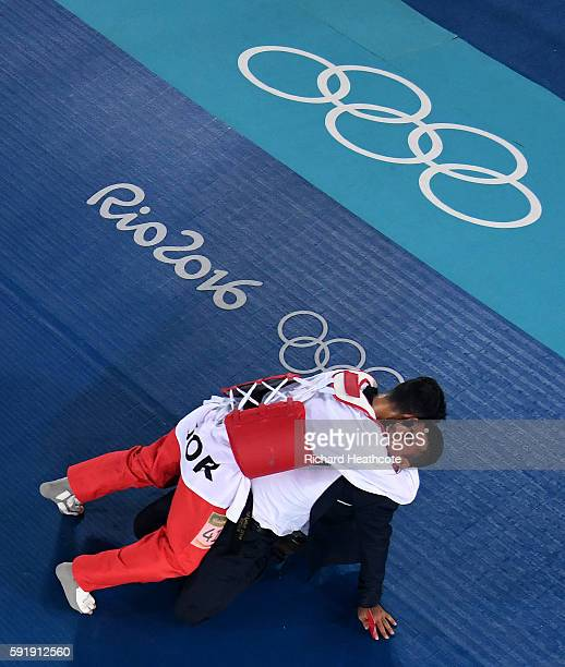 Ahmad Abughaush of Jordan celebrates after defeating Alexey Denisenko of Russia during the men's 68kg Gold Medal Taekwondo contest at the Carioca...