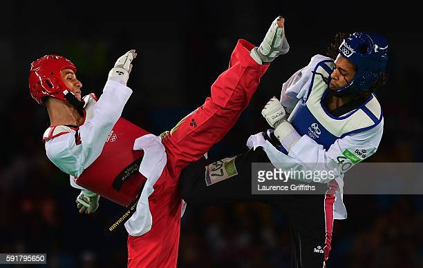 Ahmad Abughaush of Jordan competes against Ghofran Ahmed of Egypt during the Mens 68kg Taekwondo contest at Cairoca Arena 3 on August 18 2016 in Rio...