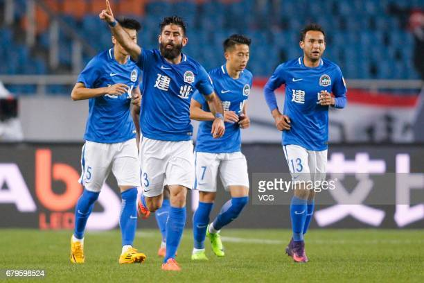 Ahmad Al Saleh of Henan Jianye celebrates a point with teammates during the eighth round match of 2017 Chinese Football Association Super League...