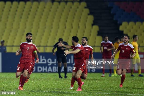 Ahmad Al Saleh of Syria celebrates after scoring the equaliser in the final minute during the 2018 FIFA World Cup Asian Qualifier Group A Final Round...