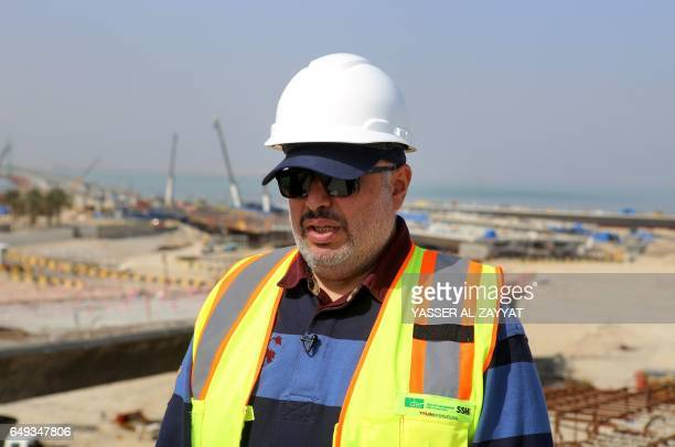 Ahmad AlHassan assistant undersecretary for road engineering at the public works ministry talks to reporters at the construction site of the Jaber...
