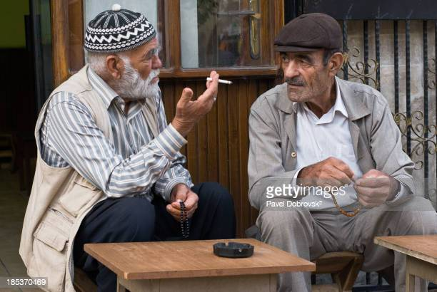 Ahmad and Selim from Sanliurfa, Turkey, are seen here in tea house, debating politics.