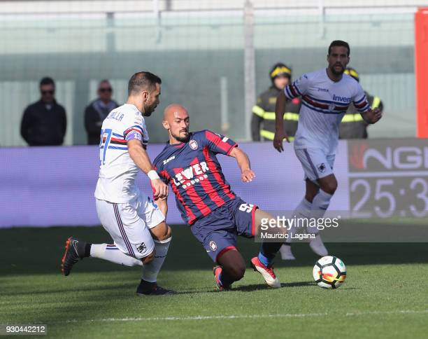 Ahmad Benali of Crotone competes for the ball with Fabio Quagliarella of Sampdoria during the serie A match between FC Crotone and UC Sampdoria at...