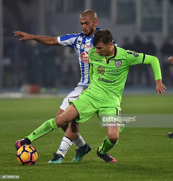 Ahmad Benali of Pescara Calcio and Nicolo' Barella of Cagliari Calcio in action during the Serie A match between Pescara Calcio and Cagliari Calcio...