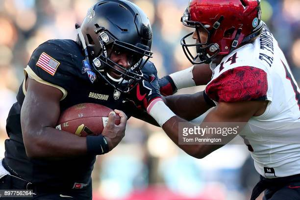 Ahmad Bradshaw of the Army Black Knights carries the ball against Tariq Thompson of the San Diego State Aztecs in the first half on December 23 2017...