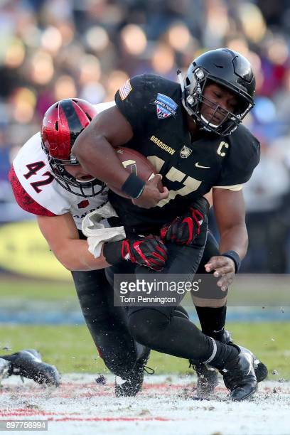 Ahmad Bradshaw of the Army Black Knights carries the ball against Troy Cassidy of the San Diego State Aztecs in the first half of the Lockheed Martin...