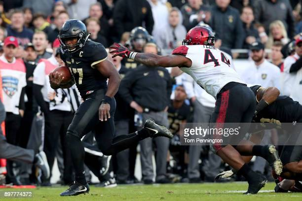 Ahmad Bradshaw of the Army Black Knights scores a touchdown against Kyahva Tezino of the San Diego State Aztecs in the fourth quarter in the Lockheed...