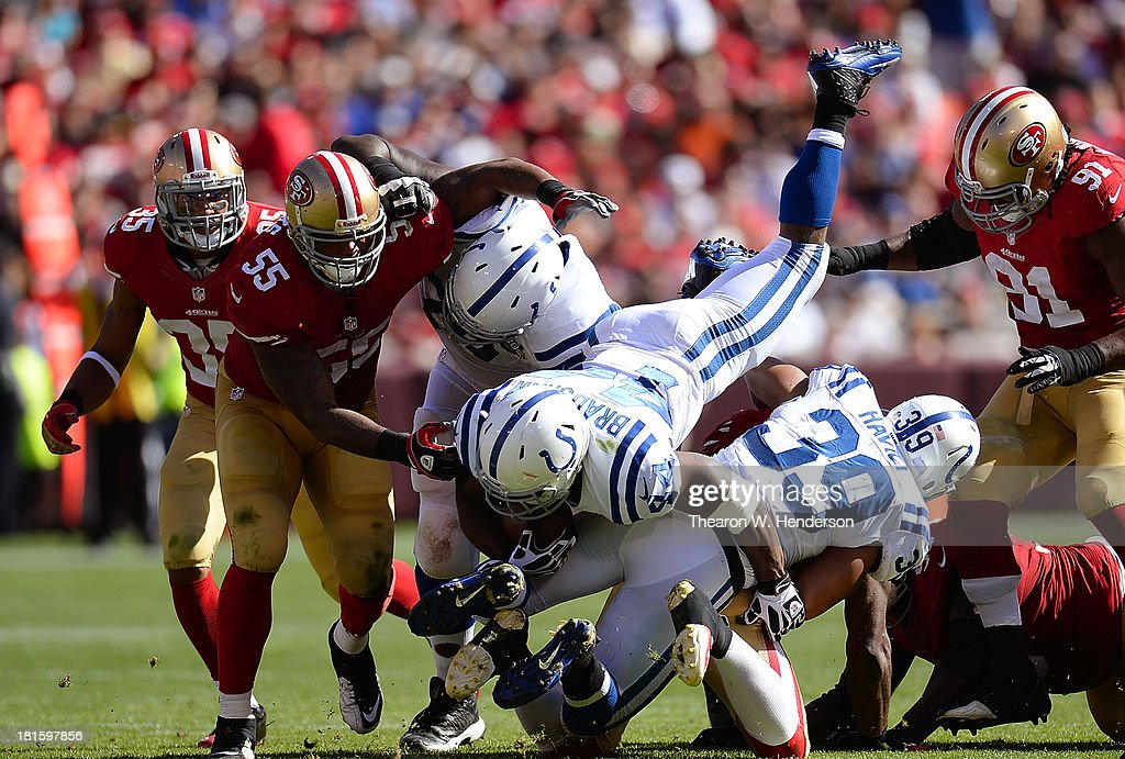 Ahmad Bradshaw #44 of the Indianapolis Colts dives over teammate Stanley Havili #39 of a seven yards gain against the San Francisco 49ers during the fourth quarter at Candlestick Park on September 22, 2013 in San Francisco, California. The Colts won the game 27-7.