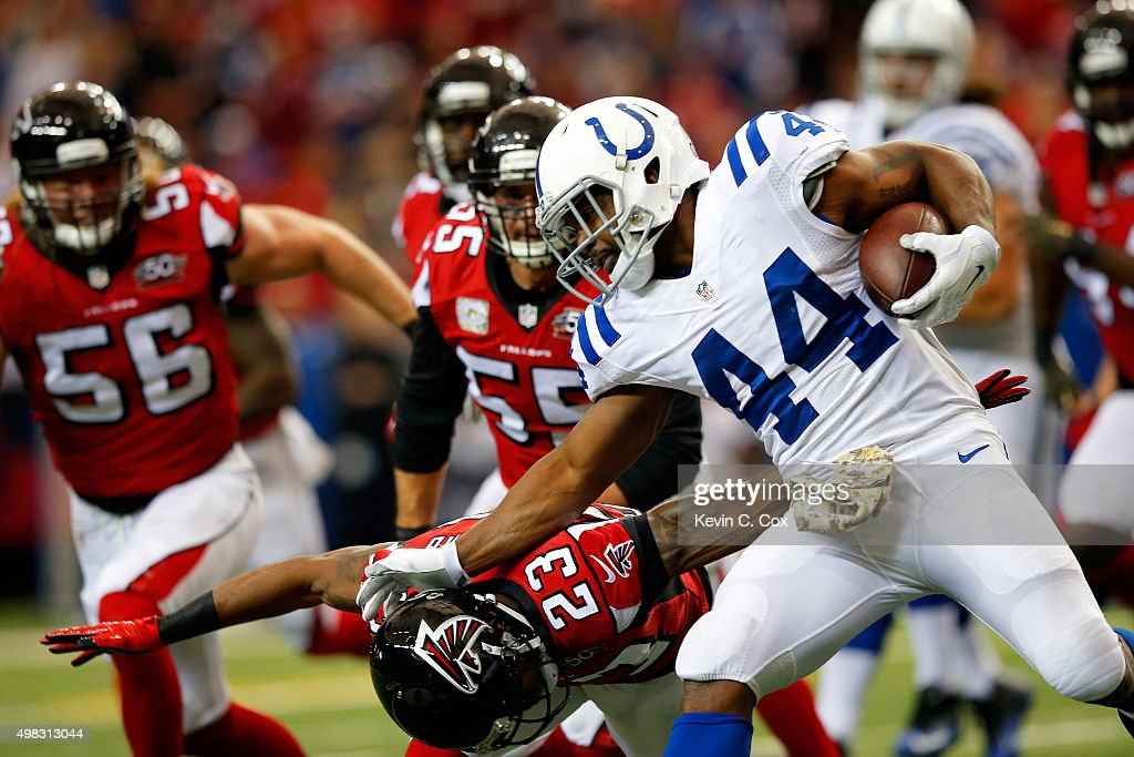 Ahmad Bradshaw #44 of the Indianapolis Colts stiff arms Robert Alford #23 of the Atlanta Falcons during the first half at the Georgia Dome on November 22, 2015 in Atlanta, Georgia.