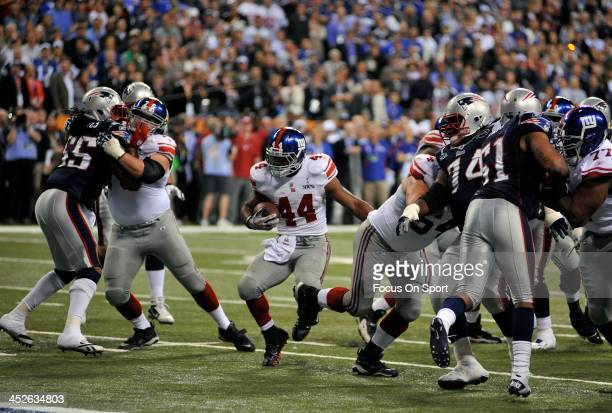 Ahmad Bradshaw of the New York Giants carries the ball against the New England Patriots during Super Bowl XLVI February 5 2012 at Lucas Oil Stadium...