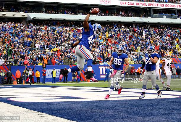 Ahmad Bradshaw of the New York Giants celebrates his touchdown against the Cleveland Browns during their game at MetLife Stadium on October 7 2012 in...
