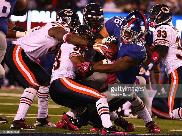 Ahmad Bradshaw of the New York Giants runs the ball for a touchdown against Charles Tillman Danieal Manning and Mark Anderson of the Chicago Bears at...