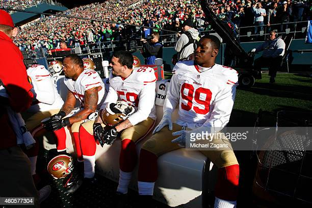 Ahmad Brooks Aaron Lynch and Aldon Smith of the San Francisco 49ers sit on the bench during the game against the Seattle Seahawks at CenturyLink...