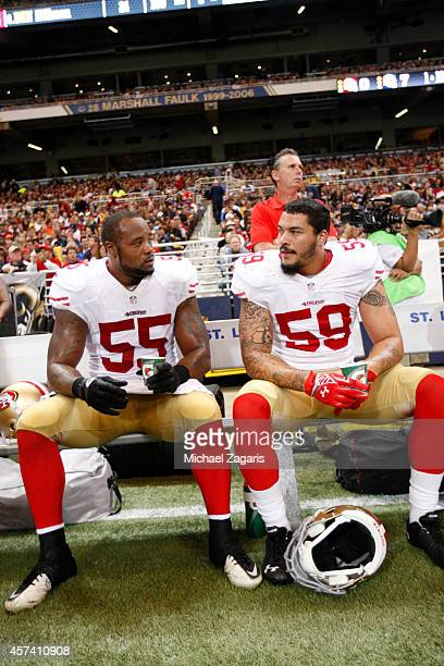 Ahmad Brooks and Aaron Lynch of the San Francisco 49ers sit on the bench during the game against the St Louis Rams at the Edward Jones Dome on...