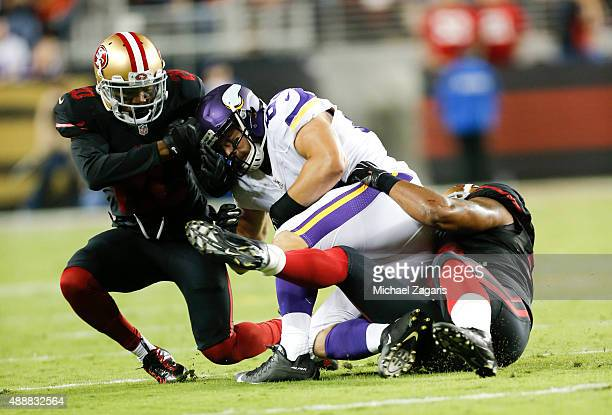 Ahmad Brooks and Kenneth Acker of the San Francisco 49ers tackle Rhett Ellison of the Minnesota Vikings during the game at Levi Stadium on September...