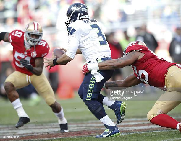 Ahmad Brooks of the San Francisco 49ers drags down Russell Wilson of the Seattle Seahawks during the game at Levi Stadium on January 1 2017 in Santa...