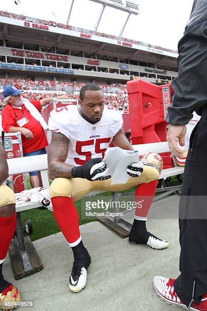 Ahmad Brooks of the San Francisco 49ers reviews game images during the game against the Tampa Bay Buccaneers at Raymond James Stadium on December 15...