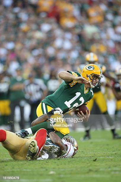 Ahmad Brooks of the San Francisco 49ers sacks Aaron Rodgers of the Green Bay Packers during the game at Lambeau Field on September 9 2012 in Green...