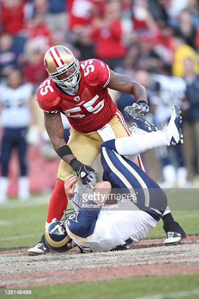 Ahmad Brooks of the San Francisco 49ers stands over a sacked AJ Feeley of the St Louis Rams during the game at Candlestick Park on December 4 2011 in...