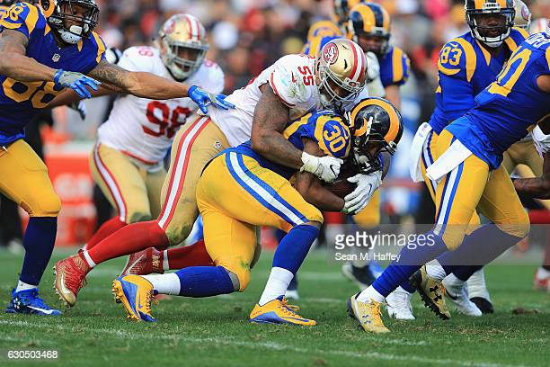 Ahmad Brooks of the San Francisco 49ers tackles Todd Gurley of the Los Angeles Rams during the first half of their game at Los Angeles Memorial...