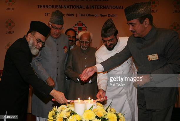 Ahmad Bukhari Dr Farooq Abdullah Hamid Ansari Yahayah Bukhari and Ghulam Nabi Azad lighting the lamp at the 2nd International Conference on Terrorism...