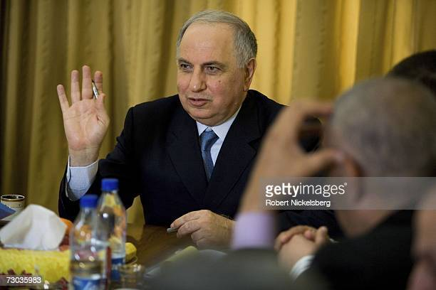 Ahmad Chalabi gestures during a meeting of his officers in the Ministry of DeBaathification at the Ministry of DeBaathification inside the Green Zone...