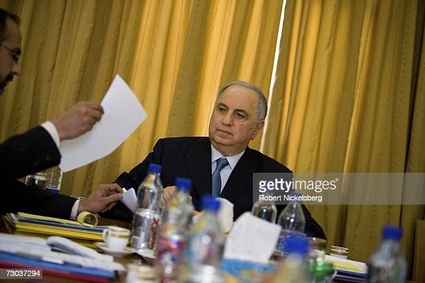 Ahmad Chalabi gestures sits a meeting of his officers in the Ministry of DeBaathification at the Ministry of DeBaathification inside the Green Zone...