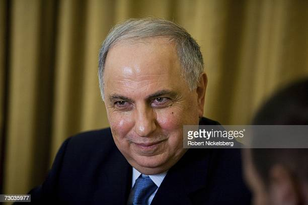 Ahmad Chalabi listens during a meeting of his officers in the Ministry of DeBaathification at the Ministry of DeBaathification inside the Green Zone...