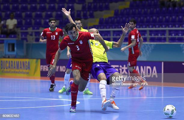 Ahmad Esmaeilpour of Iran and Ari of Brazil vie for the ball during round of 16 match play in the 2016 FIFA Futsal World Cup at Coliseo Bicentenario...