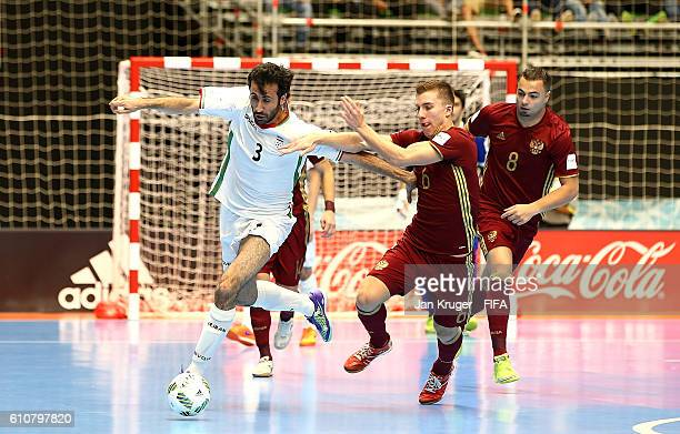 Ahmad Esmaeilpour of Iran battles with Ivan Chishkala of Russia during the FIFA Futsal World Cup semifinal match between Iran and Russia at Coliseo...
