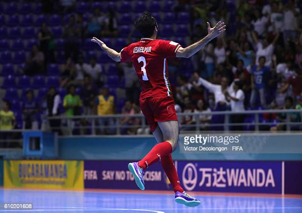 Ahmad Esmaeilpour of Iran celebrates after scoring the goahead goal late in the second half of extra time during quarterfinal match play between...