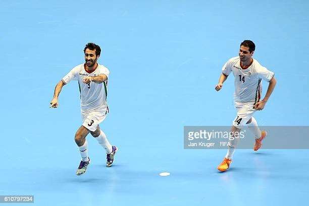 Ahmad Esmaeilpour of Iran celebrates the equilizer with team mates during the FIFA Futsal World Cup semifinal match between Iran and Russia at...