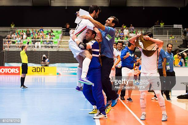 Ahmad Esmaeilpour of Iran celebrates with players and staff members in the bench after scoring his team's first goal during the FIFA Futsal World Cup...