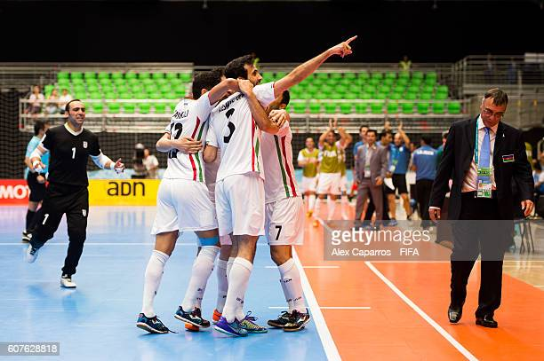 Ahmad Esmaeilpour of Iran celebrates with teammates after scoring the opening goal during the FIFA Futsal World Cup Group F match between Azerbaijan...