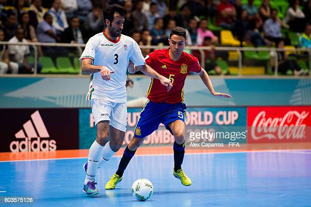 Ahmad Esmaeilpour of Iran competes for the ball with Aicardo of Spain during the FIFA Futsal World Cup Group F match between Iran and Spain at...