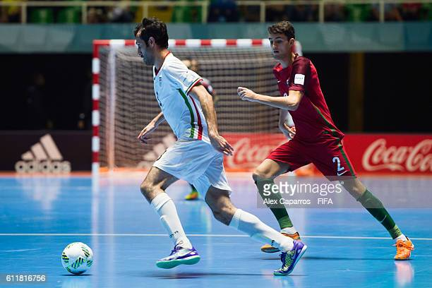 Ahmad Esmaeilpour of Iran conducts the ball next to Andre of Portugal during the FIFA Futsal World Cup Third Place Play off match between Iran and...