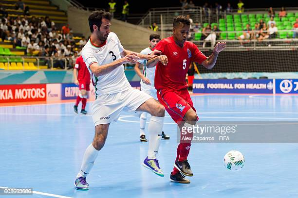 Ahmad Esmaeilpour of Iran fights for the ball with Fineo of Azerbaijan during the FIFA Futsal World Cup Group F match between Azerbaijan and Iran at...