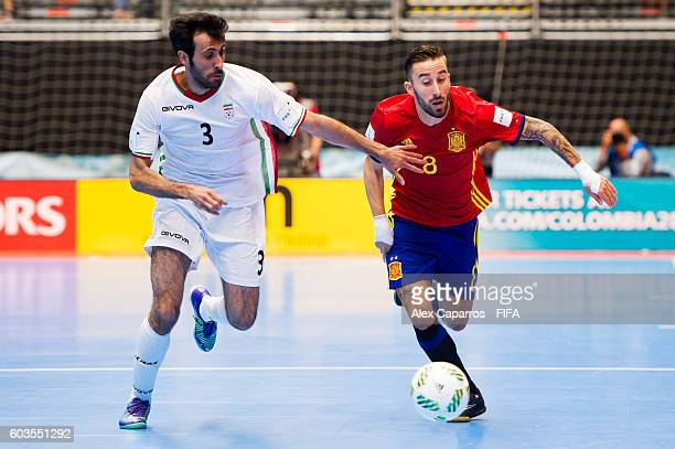 Ahmad Esmaeilpour of Iran fights for the ball with Rivillos of Spain during the FIFA Futsal World Cup Group F match between Iran and Spain at Coliseo...