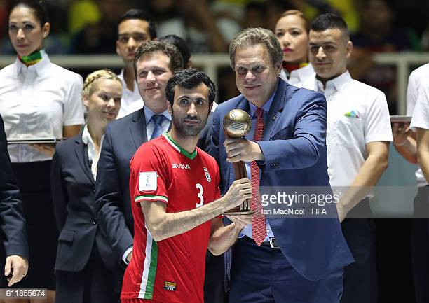 Ahmad Esmaeilpour of Iran is presented with his Bronze Ball Award during the FIFA Futsal World Cup Final match between Russia and Argentina at the...