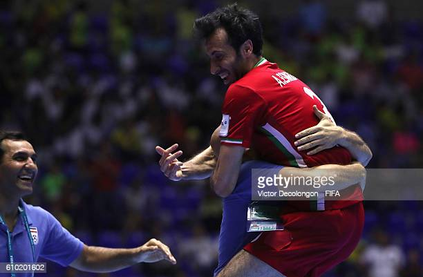 Ahmad Esmaeilpour of Iran jumps into the arms of a team trainer after scoring the goahead goal late in the second half of extra time during...