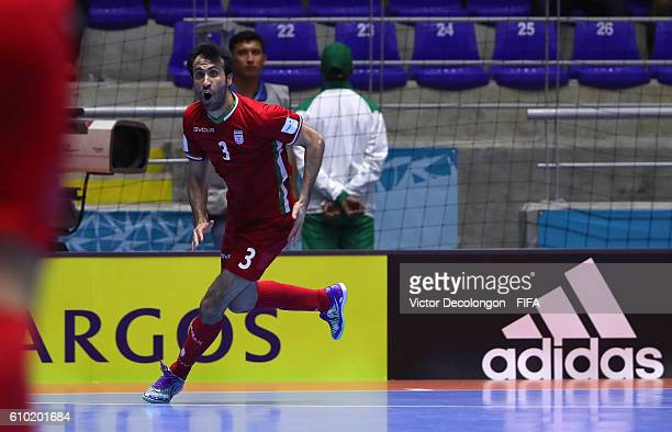 Ahmad Esmaeilpour of Iran reacts after scoring the goahead goal late in the second half of extra time during quarterfinal match play between Paraguay...