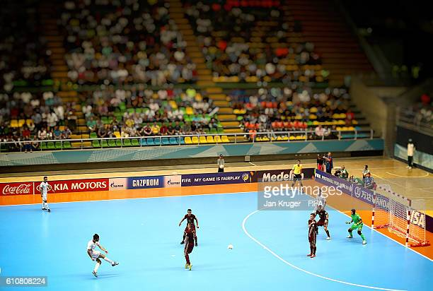 Ahmad Esmaeilpour of Iran scores his sides second goal during the FIFA Futsal World Cup semifinal match between Iran and Russia at Coliseo Ivan de...