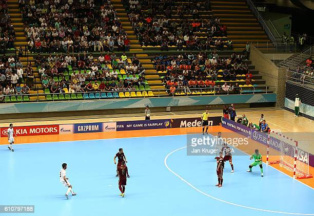 Ahmad Esmaeilpour of Iran scores the equilizer during the FIFA Futsal World Cup semifinal match between Iran and Russia at Coliseo Ivan de Bedout on...